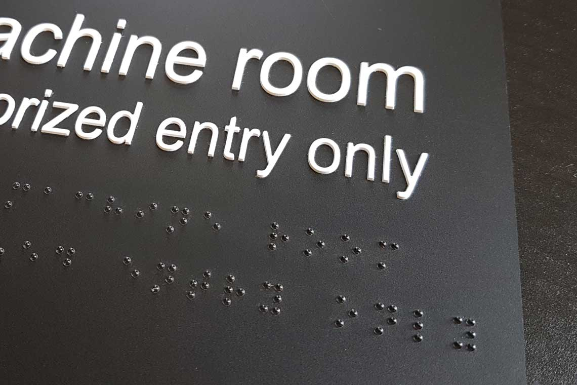 Braille and tactile signage