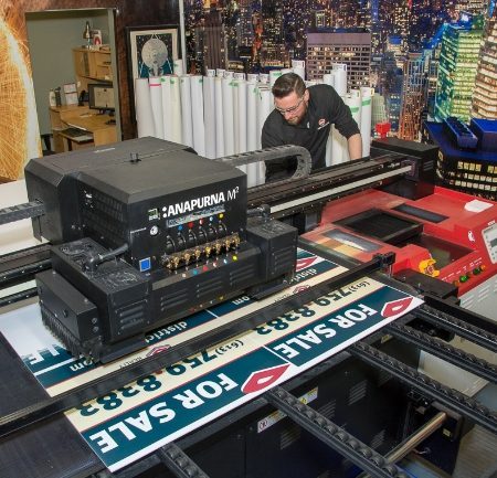 Miller McConnell staff member using our HP 570 wide format printer